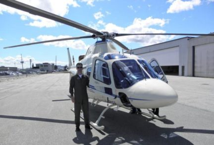 An AW119ke helicopter on the tarmac.