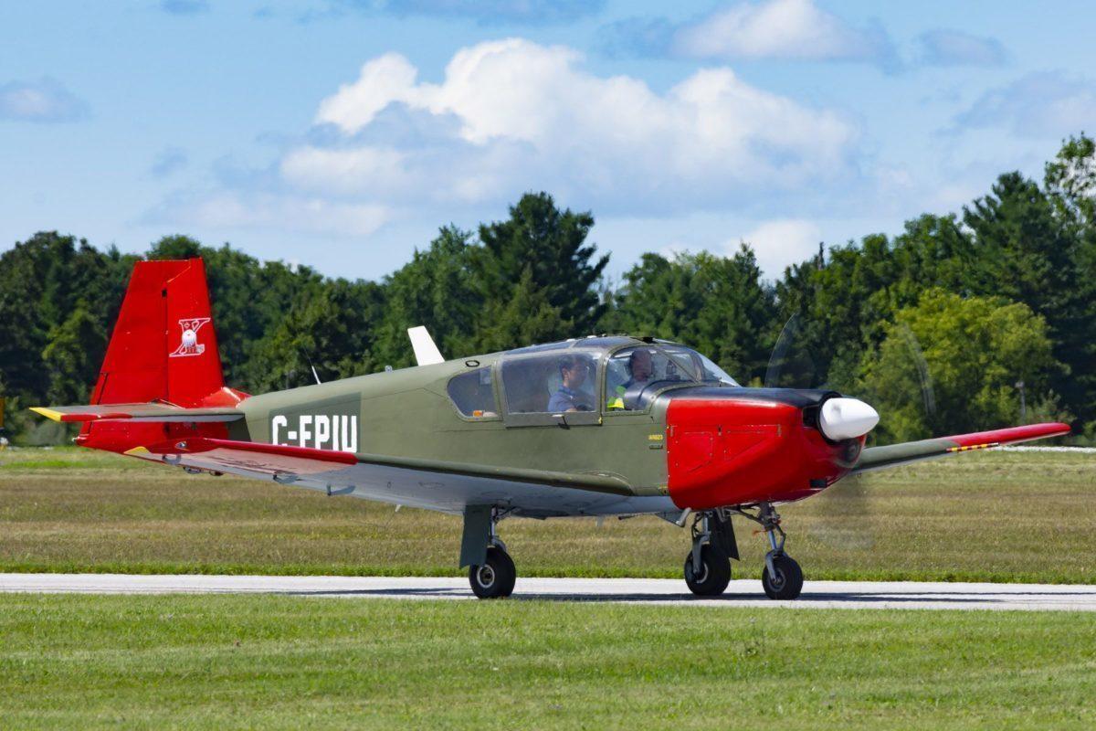 Green and red Brassov airplane