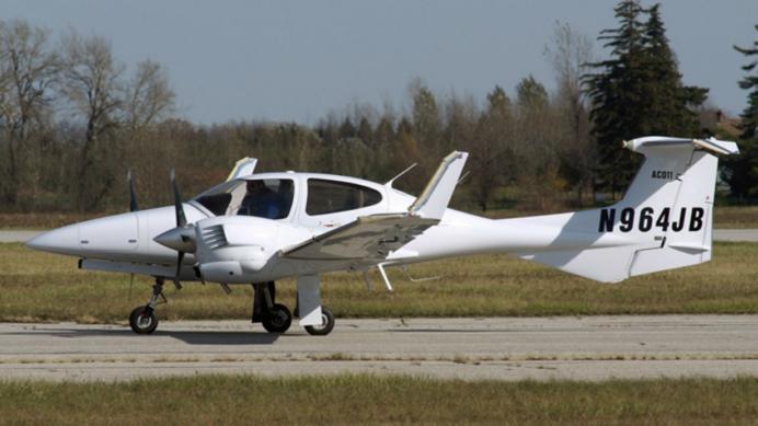 A Diamond Aircraft DA 42 on the runway.