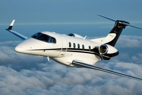 Black and white Embraer Phenom 300 aircraft.