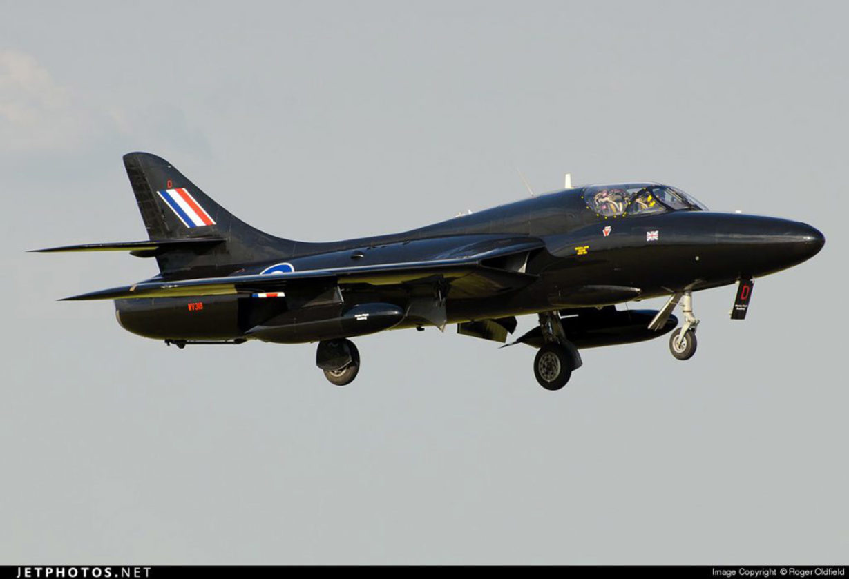 Black Hunter Hawker T-55 flying in the air.