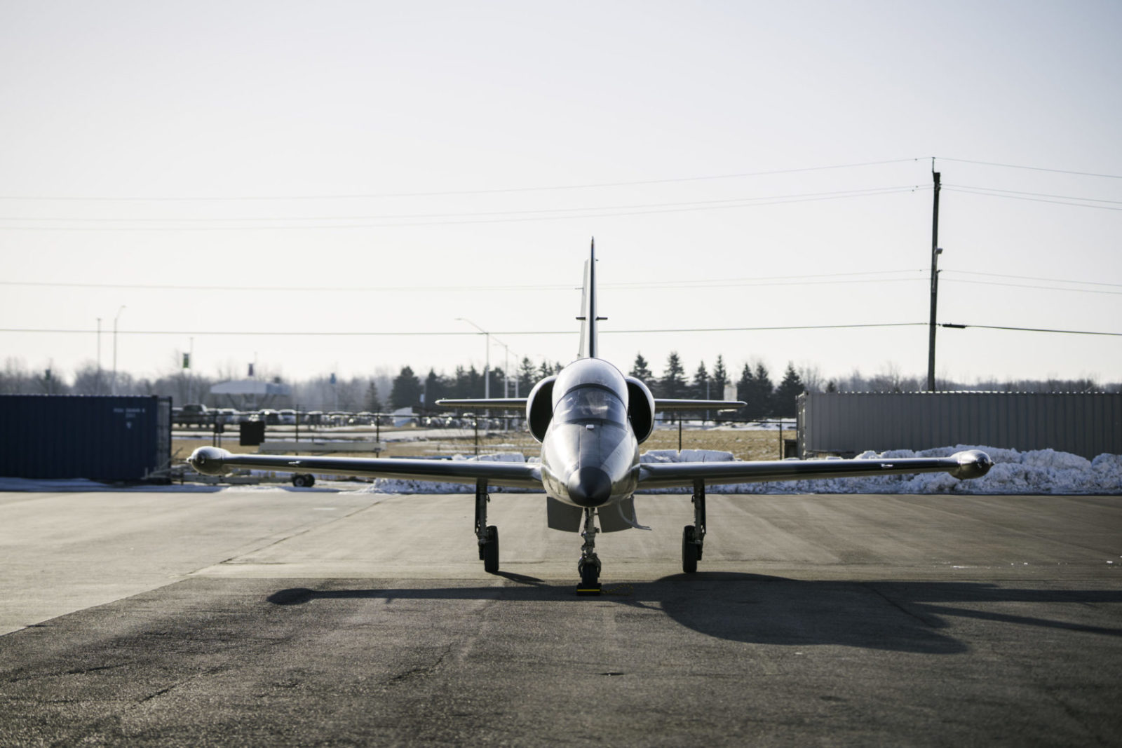 Front view of an L-39 Jet on a runway