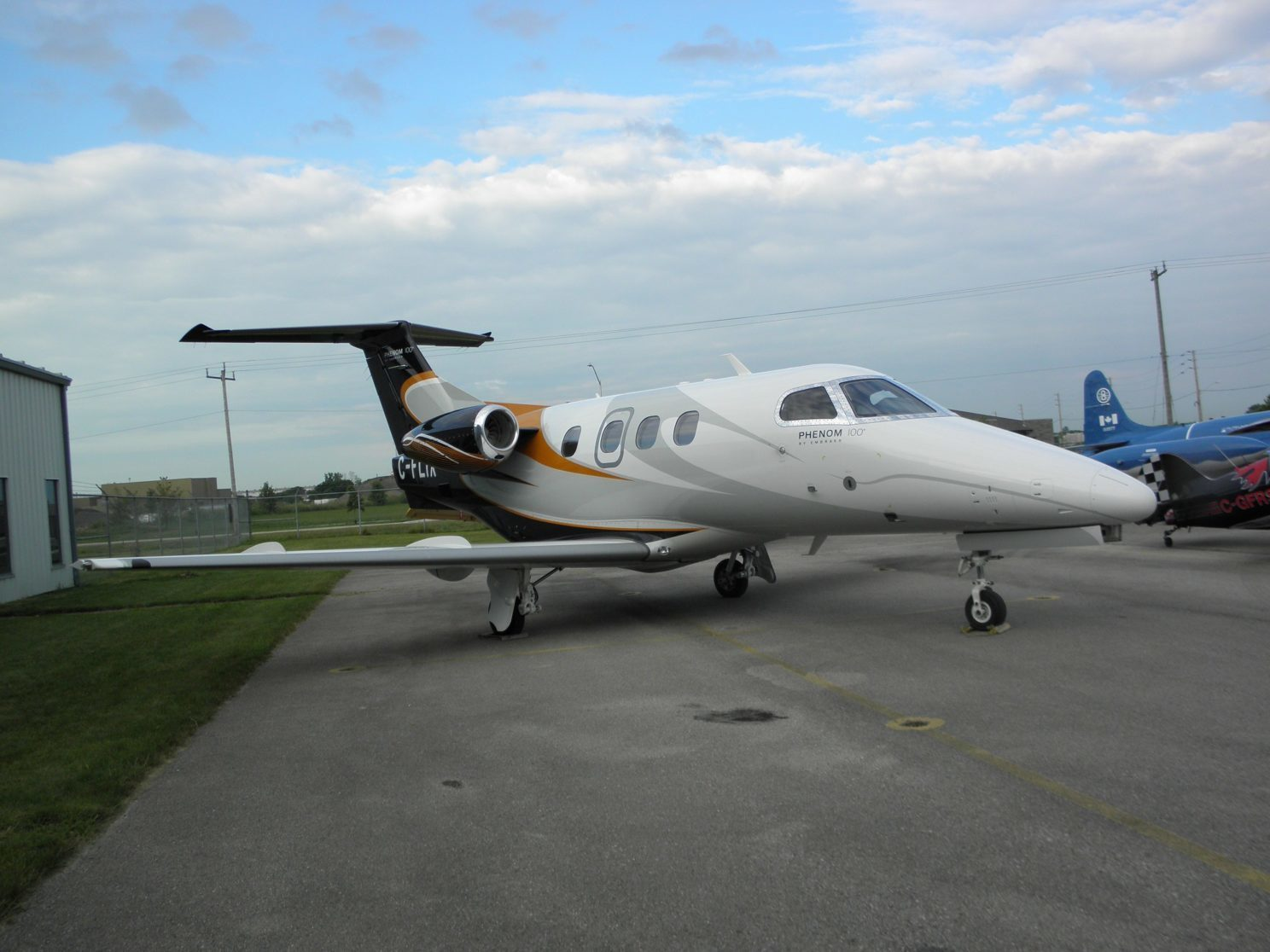 Black and white Embraer Phenom 100 aircraft.
