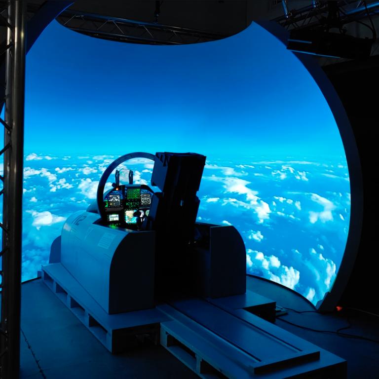 View into a F-18 aircraft simulator.