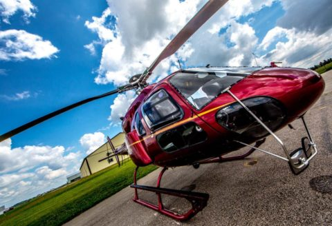 A red Squirrel AS350 helicopter.