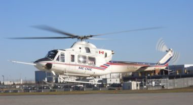 A white Bell 212 Variable Stability helicopter.