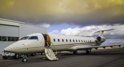 An IPTS Challenger aircraft sitting on the tarmac.