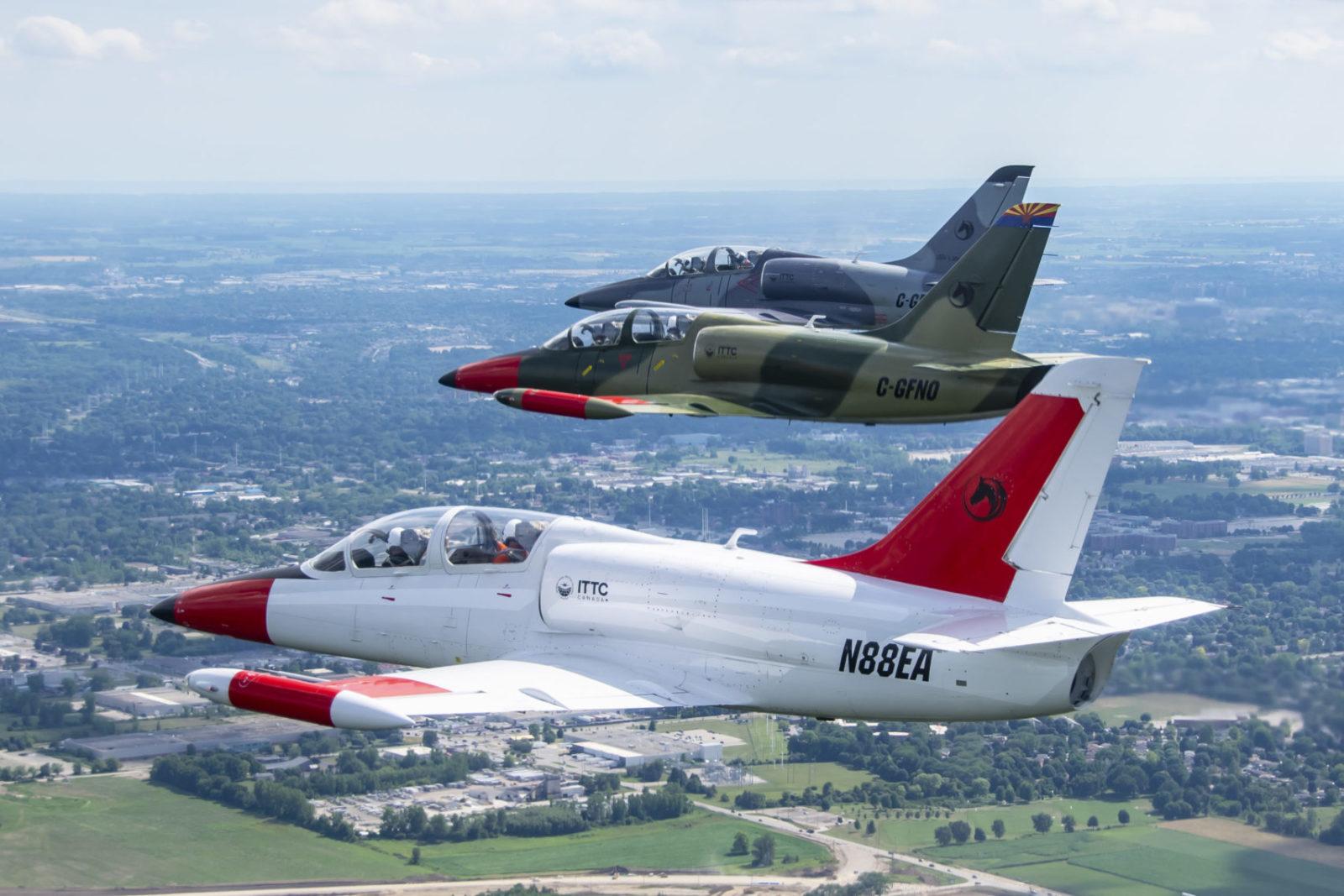 Three Aero Vodochody L39 aircraft in the sky.