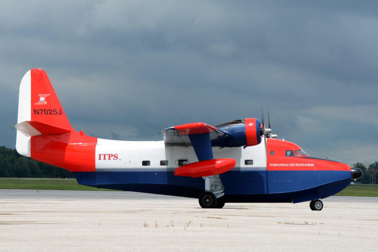 Red and blue Grumman HU-16 Albatross Aircraft.
