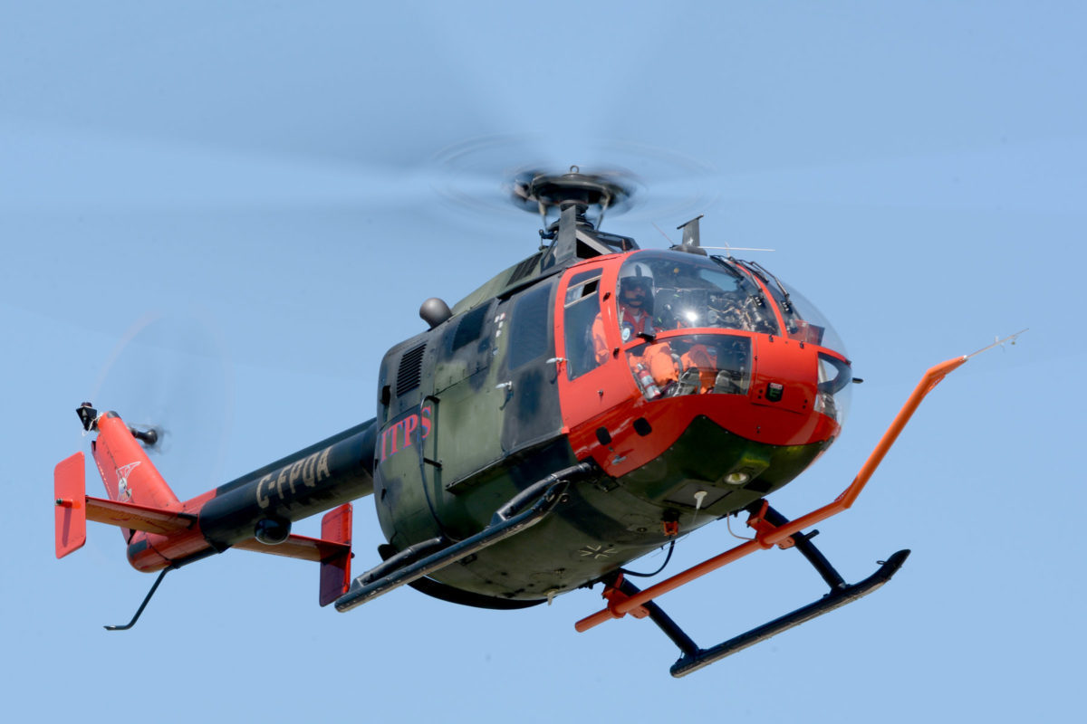 Green and red MBB Bo105 helicopter