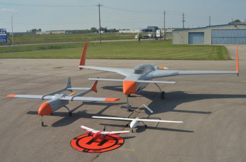 Grey and orange unmanned remotely piloted aircraft.