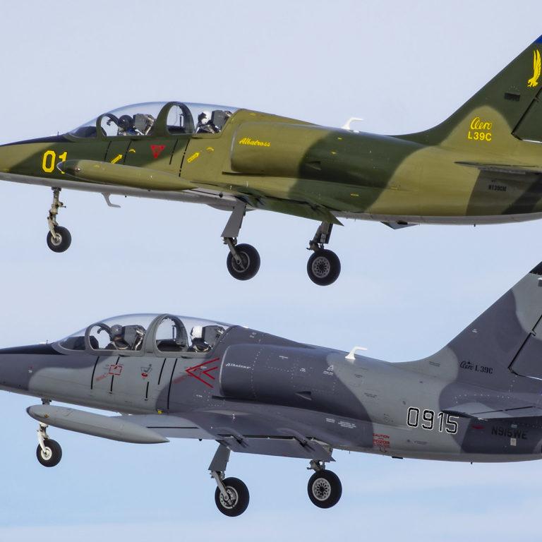 Two Aero Vodochody L39 aircraft flying.