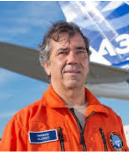 Ferdinand Alonso in orange flight suit.