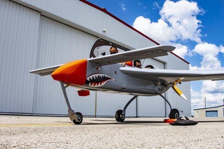Manned remotely piloted aircraft. Grey and orange aircraft.