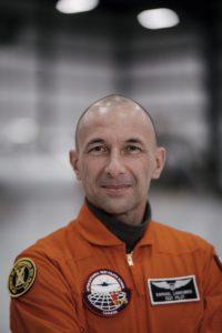 Raphael Web in orange flight suit.