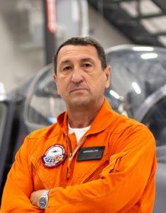 Constantin Stan in an orange flight suit.