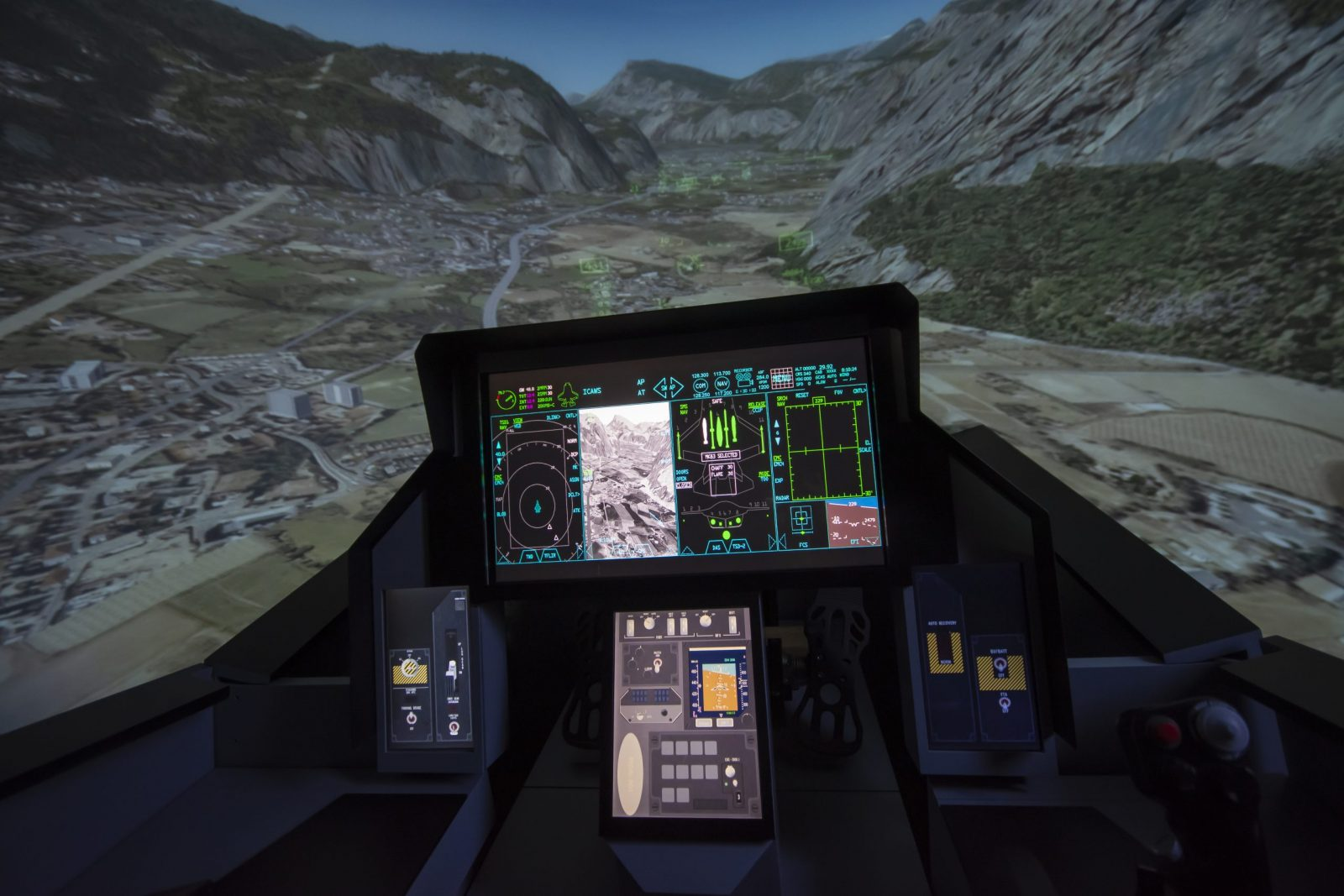 F-18 aircraft simulator with terrain in the background.