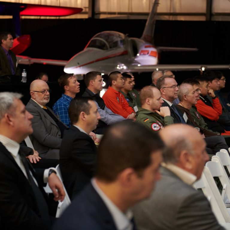 Attendees at Annual Flight Test Seminar and Graduation at International Test Pilots School hangar.
