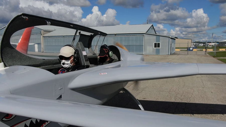 Gustavo Ullao in a grey and orange manned remotely piloted aircraft.